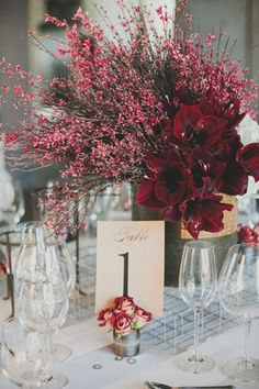 #MarsalaWedding red branch centerpiece for  with table number