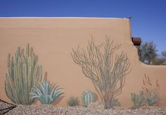 Riggs had a friend and artist paint a mural of desert plants on this wall.