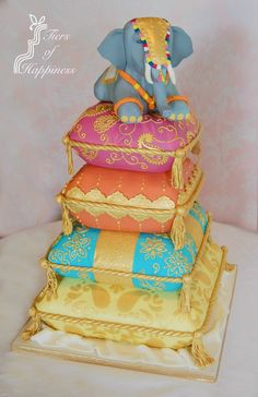Indian elephant on decorative cushions wedding cake www.tiersofhappiness.net…