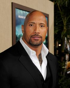 """Dwayne Johnson Photos Photos - Actor Dwayne Johnson arrives at the premiere of Warner Bros. Pictures' """"Journey 2: The Mysterious Island"""" at the Chinese Theater on February 2, 2012 in Los Angeles, California. - The Red Carpet at the 'Journey 2' Premiere"""