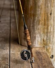 Custom-built, one-of-a-kind bamboo fly rod handcrafted by Ira Stutzman in Hells Canyon, ideal for small stream trout fishing.