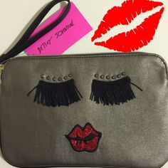 """Betsey Johnson Fancy Face Wristlet Fabulously fun wristlet by Betsey Johnson...get fancy with this silver wristlet...her pretty face is made up of black fringe eyelashes,pewter studs as eyebrows and let's not forget about those amazing bright red glitter lips✨✨!!!..wristlet has zip closure and measures 9.5""""x6""""...get ready for the holiday season with this unique wristlet!!❤️❤️ Betsey Johnson Bags Clutches & Wristlets"""