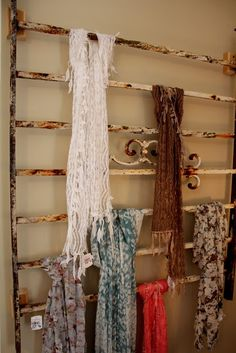 Old iron fence to hang scarves,  Makes a great display for store