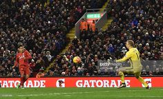 Roberto Firmino of Liverpool scores the third goal during the Barclays Premier League match between Liverpool and Manchester City at Anfield on March 2, 2016 in Liverpool, England.