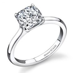 Elegant and modern 2mm wide Solitaire diamond ring made to fit flush with any wedding band. Ring is shown with a Cushion cut diamond, but can be made to fit any diamond shape.