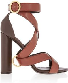 Heel measures approximately inches Brown and dark-brown leather  Buckle-fastening ankle strap Designer color: Cinnamon/ Dark Brown