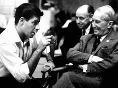 Visiting the set of The Patsy, Maurice Chevalier listens in amusement to director-star Jerry Lewis
