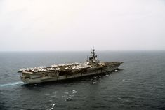 An aerial starboard quarter view of the aircraft carrier USS FORRESTAL (CV-59) underway, 15 Jun 1982 Source ID:DM-ST-83-01803 / Service Depicted: Navy / National Archive# NN33300514 2005-06-30 Author USN