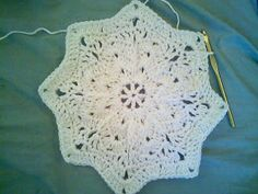 8 Points Round Ripple Blanket by Mari from Singular:Yarn.  It is snowflake like in appearnance and looks soft and delicate.