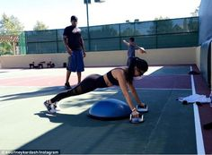 Working it out: On Thursday, the E! star shared a photo to her Instagram while in the midst of another outdoor workout with her trainer Don-A-Matrix, writing: 'He kills me'