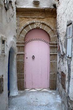 Pink door! Behind this....home. (as well as an amazing inner courtyard with a beautiful fountain and cozy furniture to sit and have coffee with a good book)