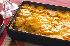 Carrots, onions and cheddar cheese give this scalloped potato side dish added flavour and colour. With 12 servings, it's the perfect scalloped potato bake for big family gatherings.