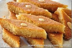 Harisa or Basbousa is a popular Middle Eastern sweet made of Semolina. Get the recipe for this yummy dessert soaked in sugar syrup at http://www.dish-away.com/2012/08/harisa-recipe.html#