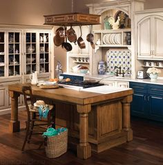 I'm not a fan of white cabinets, but I am drawn to this blue/white/copper color scheme
