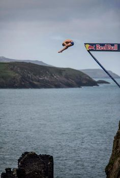 Michal Navratil of the Czech Republic dives from the 27.5 metre platform at the Blue Lagoon during the first round of the sixth stop of the Red Bull Cliff Diving World Series, Pembrokeshire, Wales, UK on September 7th 2012. www.redbullcliffdiving.com