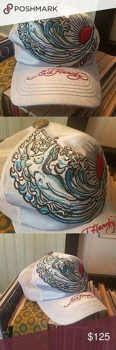 Ed Hardy California Wave Trucker Hat Light blue satin brim and front of hat with the design sew in. Back of hat is trucker style with snapback. Have seen many of his hats, but not one like this. Would of listed for more, but inside rim is alittle discolored and some fraying around front of bill. Other than that this is the coolest Ed Hardy I have ever seen. It has been in my collection for along time. Super cool, so much so that I only wore it a couple if times. Sat on a shelf like a trophy…