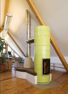 Round wood stove with Ortner stove inside.