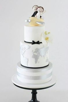 Cute Black & Silver Wedding Cake with White Orchid & Map of World. Created  by Sharon Wee Designs