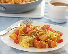 Cheesy Bacon, Potato &  Egg Scramble - 1. Lightly spray a 12-inch nonstick skillet with cooking spray. Scramble eggs over medium heat. 2. Stir in prepared Roasted Potatoes with Bacon and tomato. heat thorugh. Serve sprinkled with green onions.
