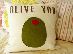I've been heavily into throw pillows as of late. This one is precious - felt olive! Love it... Time to fire up the sewing machine.