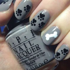 The thing we love this manicure's versatility. You can use any colors you want and it will still look flawless. Plus, you can show your love for both cats and dogs with paw print nail art designs. This one leans toward the dog side with a bone, but you could switch up the statement nail by adding more paw prints, a food bowl, or even more fashion-forward elements like a chevron pattern or stripes.