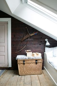 A bow and quiver of arrows definitely add a unique touch to the bedroom of this cottage in Denmark.