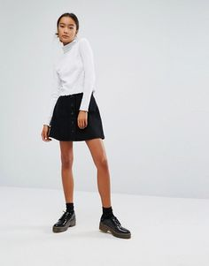 http://www.asos.com/monki/monki-button-through-a-line-denim-skirt/prd/7227873?CTAref=Complete the Look Carousel_1