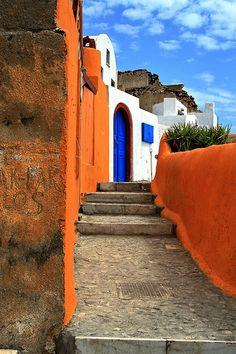 Colourful street   Blue and orange stepped alley, Oia, Santorini island, Cyclades, Greece