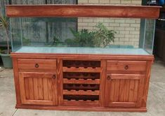 Aquariums and stands are locally made. Well made pine stands and cabinets, wine. Diy Aquarium Stand, Wall Aquarium, Cichlid Aquarium, Aquarium Pump, Home Aquarium, Aquarium Design, Aquarium Fish Tank, Aquarium Ideas, Saltwater Fish Tanks