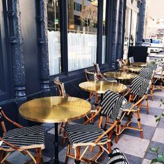 brass tables and black & white wicker chairs
