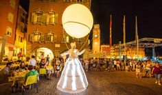 Lighting balloons on stilts | Stilts walkers | Walk around acts | Others | Performers | Entertainment Agency | Corporate Event Entertainment