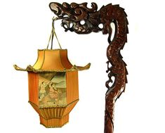 Intricately carved dragon stand, details at the base and raised upon four clawed feet with little faces on the feet, Fantastic piece of art! Such details & beautiful custom carving - solid brown wood & very heavy. Will email more images upon request. Lamp: 72 Height approx x 16 Wide