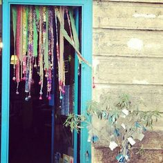 Bohemian curtains - I like the pom pom ends to the ribbons