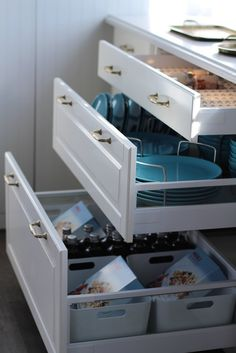 Ikea's new Sektion cabinet organizers help to squeeze out as much utility as possible. These plate organizers make it easy to keep extra plates in drawers if you run out of cabinet space.