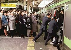 During rush hour they squeeze passengers onto the train like sardines! Tokyo Japan
