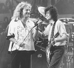 Great shot of Robert Plant and Jimmy Page laughing together on stage;) 90's