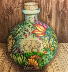 Finished! 'Jumbo in a Bottle' from Magical Jungle #johannabasford #magicaljungle. First time I've drawn and coloured a background. Am happy with the result although it was nerve wracking doing it! Used #fabercastell Polychromos and a Uniball black pen to create the wood pattern by layering black dots ❤️✏️.