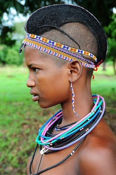Africa | Portrait of Fulani, Peul girl with braided hair and beaded necklace, Benin | © Luca Gargano