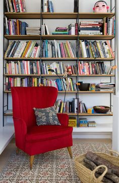 Love the tile pattern in this little Barcelona home library via Design Sponge