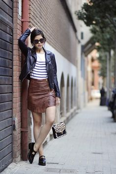 Leather jacket + striped knit top + faux leather skirt  +black loafers via @fatalfille