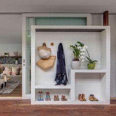 Love this idea for an entry way in a narrow hall or other small sace. Would be super cute in a ktchen too - desiretoinspire.net