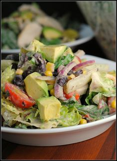 Chipotle Chicken Salad with tomatoes, avocado, red onion, black beans and corn.