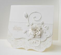 mostly white card with gorgeous flower and relaed stuff...like the double layer of the die cut  bottoms edge...