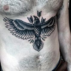 Male Upper Stomach Tattoo Of Bird Flying With Three Arrows In Black Ink