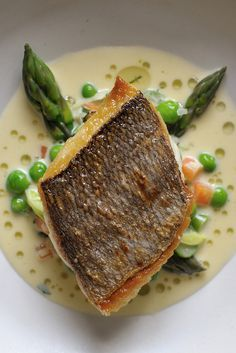 The firm flesh of bream in Nathan Outlaw's recipe is complemented by the sweet flavour of cream-enriched tartare-style sauce flecked with potatoes, asparagus, lettuce and peas. You can buy two large, whole fish if you want to fillet them yourself, or ask Fish Dishes, Seafood Dishes, Seafood Recipes, Salmon Recipes, Recipes Dinner, Slow Cooker Recipes, Cooking Recipes, Healthy Recipes, Cooking Ideas