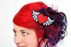 Hey, I found this really awesome Etsy listing at https://www.etsy.com/listing/84068145/winged-heart-hair-clip-red-and-silver