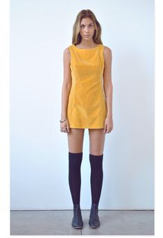 """@Amanda Shoemaker of """"One of Each"""" pairs a vintage dress with UO's black thigh high socks and Chelsea boots #urbanoutfitters"""