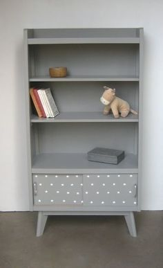 Simple chic painted grey bookcase with spotted decoupage
