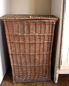 antique wicker basket to hide the kitchen trash can. Put a small shelf over top to dress it up.... Doing this by the weekend!