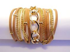 Brown suede wrap bracelet with chunky gold curb chain, gold plated beads and chains